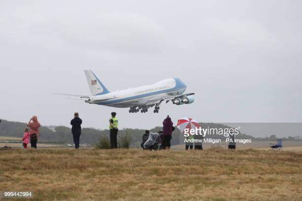 People watch as Air Force One takes off from Prestwick Airport in Ayrshire as US President Donald Trump and his wife Melania leave the UK after...