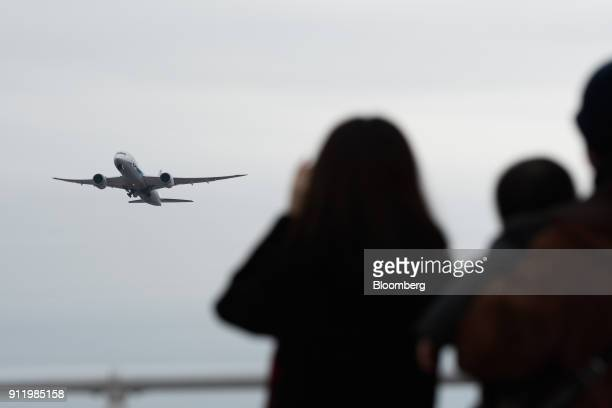 People watch as an All Nippon Airways Co aircraft takes off at Narita Airport in Narita Chiba Prefecture Japan on Sunday Jan 28 2018 ANA is scheduled...