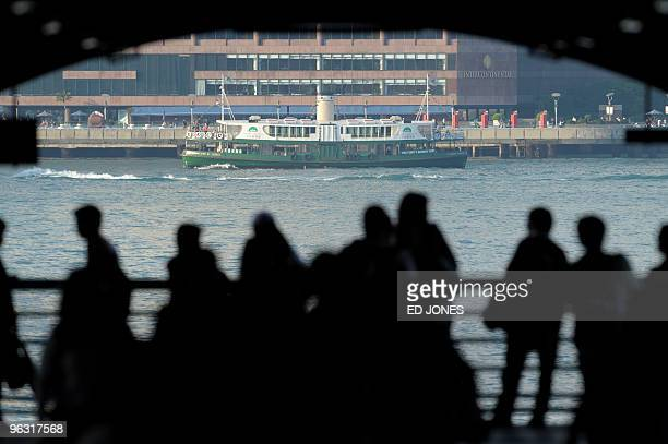 People watch as an iconic Star Ferry crosses Victoria harbour in Hong Kong on January 31 2010 AFP PHOTO/ED JONES