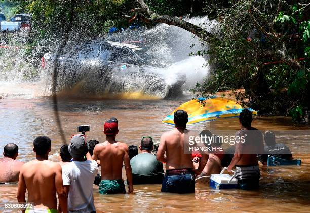 TOPSHOT People watch as competitors pass by during the 2017 Dakar Rally Stage 1 between Asuncion and Resistencia in Argentina on January 2 2017