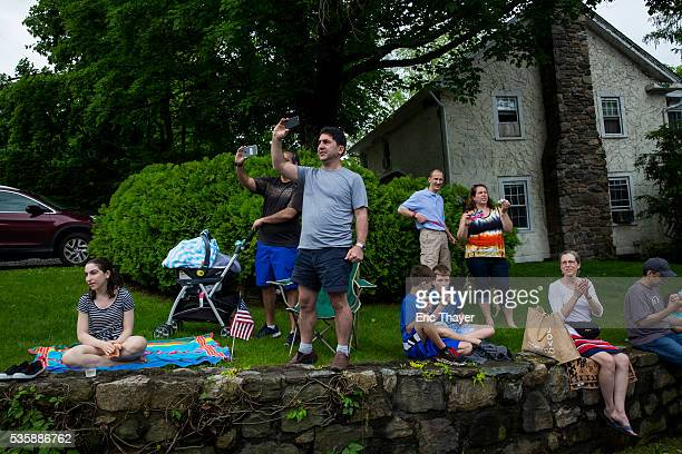 People watch as Democratic presidential candidate former Secretary of State Hillary Clinton former President Bill Clinton and New York Governor...