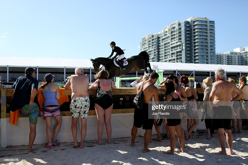 People Watch As Horse And Rider Jump A Hurdle During The Longines Global Champions Tour Stop