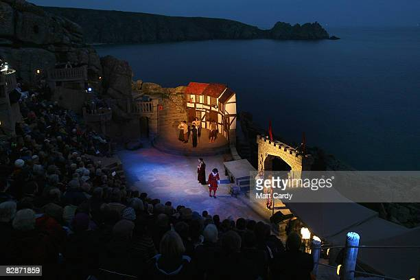 People watch as members of Cambridge University's Gilbert and Sullivan Society perform 'The Yeomen Of The Guard' at the Minack Theatre's penultimate...