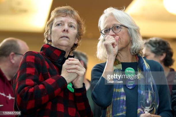 People watch as poll numbers come in during a primary night event for Democratic presidential candidate Sen Amy Klobuchar at the Grappone Conference...