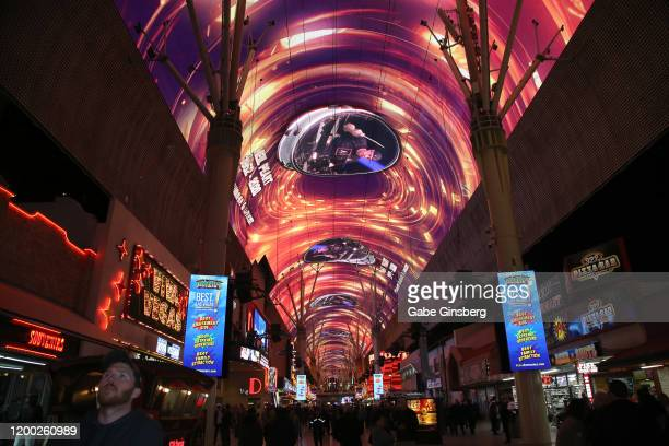 People watch as the Fremont Street Experience pays tribute to Rush drummer and Rock & Roll Hall of Fame member Neil Peart with a video retrospective...