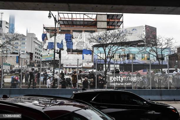 People watch as the USNS Comfort hospital ship pulls in to Pier 90 on the Hudson River on March 30 2020 in New York City The Comfort a floating...