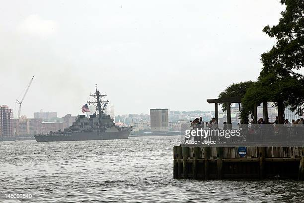 People watch as the USS Mitscher passes on the Hudson River during the Parade of Ships for the start of Fleet Week May 23 2012 in New York City Fleet...