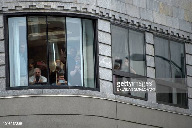 People watch as US President Donald Trump arrives for a fundraiser for US Representative Claudia Tenney on August 13 in Utica New York
