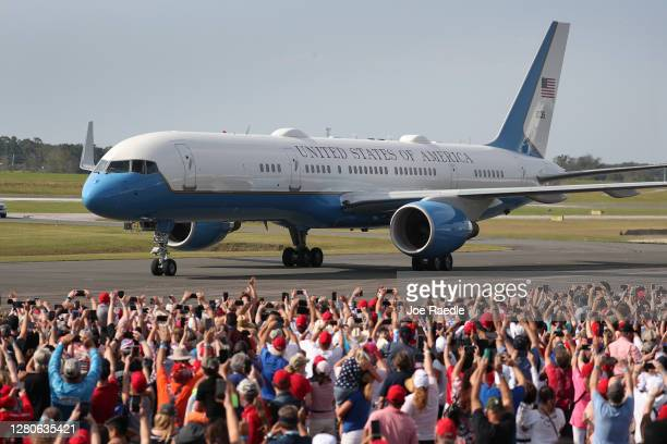 People watch as U.S. President Donald Trump arrives on Air Force One for his campaign event at the Ocala International Airport on October 16, 2020 in...