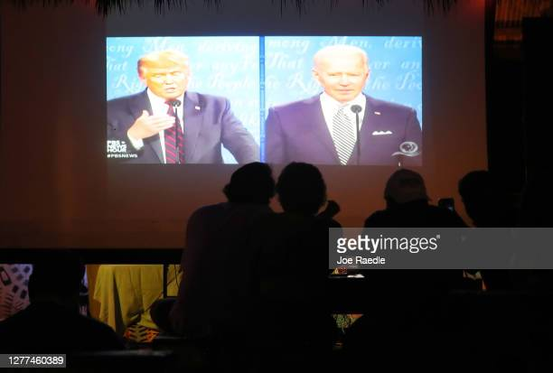 People watch at Gramps bar a television broadcasting the first debate between President Donald Trump and Democratic presidential nominee Joe Biden on...