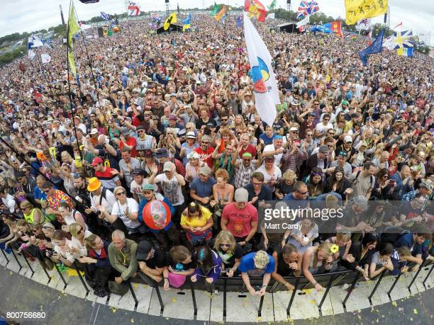 People watch Barry Gibb perform on the main Pyramid Stage at the Glastonbury Festival site at Worthy Farm in Pilton on June 25 2017 near Glastonbury...