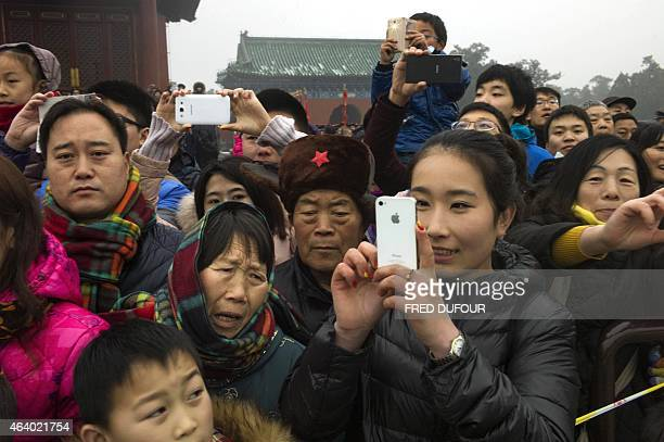 People watch Chinese performers during a traditional Qing Dynasty ceremony at the Temple of Heaven as part of the Chinese Lunar New Year festivities...