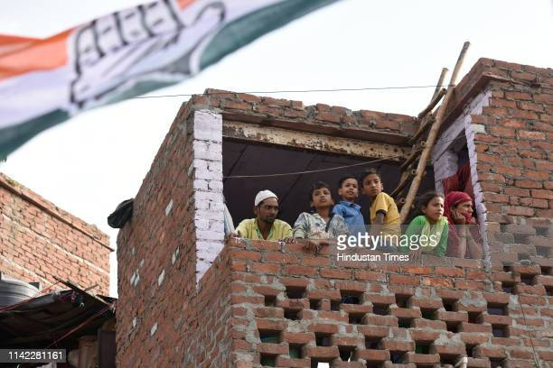 People watch Congress general secretary Priyanka Gandhi Vadra as she campaigns for Congress candidate from North East Delhi Sheila Dikshit during a...