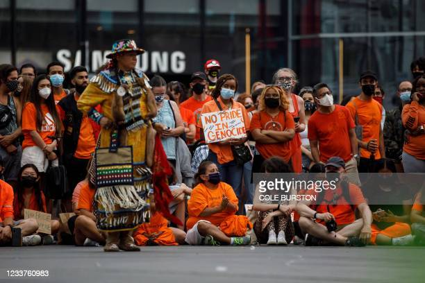 """People watch dancers perform during a """"No Pride in Genocide"""" anti-Canada Day event in Toronto, Ontario, Canada, July 1 to encourage reflection on..."""
