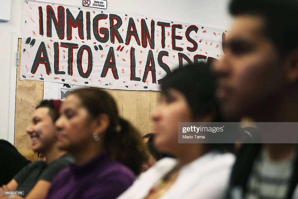 People watch during a watch party of U.S. President Barack Obama's speech on immigration on January 29, 2013 in the Queens borough of New York City. Obama called for immigration reform and a 'pathway to citizenship' for the nation's 11 million undocumented immigrants.
