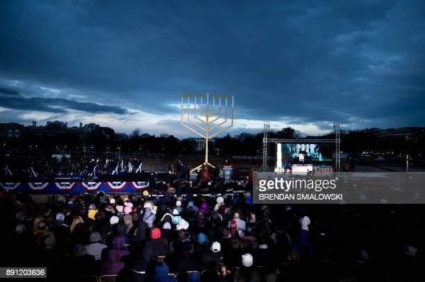 People watch during the National Chanukah Menorah lighting on the Ellipse December 12 2017 in Washington DC / AFP PHOTO / Brendan Smialowski