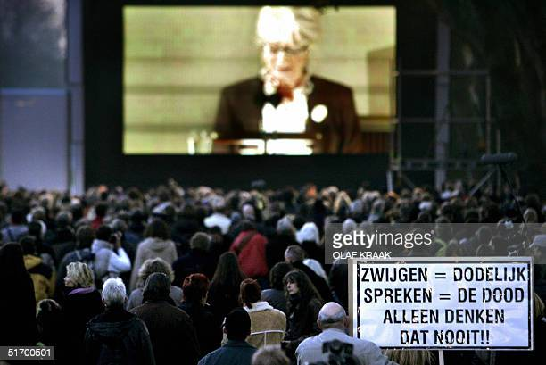 People watch Dutch filmaker Theo van Gogh's funerals on a giant screen 09 November 2004 in Amsterdam Van Gogh was killed by a suspected Islamic...