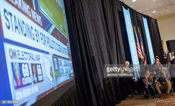 People watch early voting returns for president at the election night party for Democratic Senate candidate Katie McGinty at the Sheraton Hotel on...