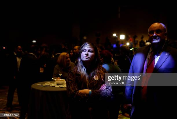 People watch election results on a monitor as they attend Democratic governor candidate JB Pritzker's primary election night event on March 20 2018...
