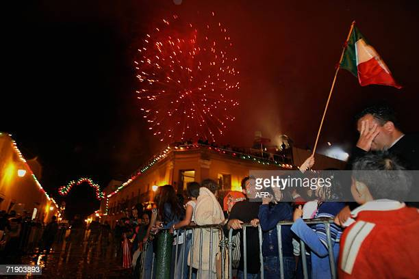 People watch fireworks display in Dolores Hidalgo Community in Guanajuato State during Mexico's Independence Day celebrations 15 September 2006 AFP...