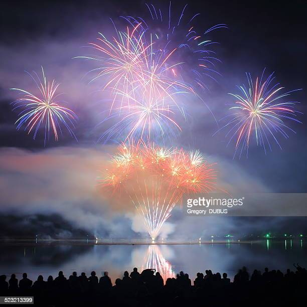 people watch fireworks display - bastille day stock pictures, royalty-free photos & images