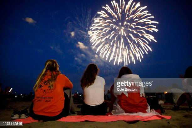 People watch fireworks fly over Ashbridges Bay during Canada Day festivities, on July 1, 2019 in Toronto, Canada. Canada Day commemorates the July 1,...