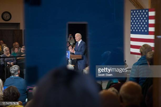 People watch from outside of the venue as Democratic presidential candidate former Vice President Joe Biden speaks during a campaign event on October...