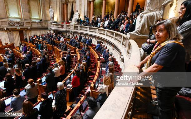 People watch from the galleries while deputies get ready to cast their nominal votes at the Assembleia da Republica during the debate in which it was...