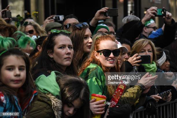 People watch from the sidelines during the annual St Patrick's Day parade along 5th Ave on March 17 2018 in New York City New York's Saint Patrick's...