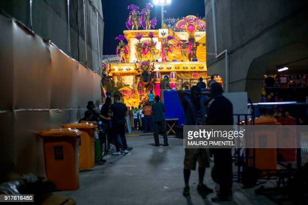 People watch from the working area as a float of the of the Salgueiro samba school passes by during the second night of Rio's Carnival at the...