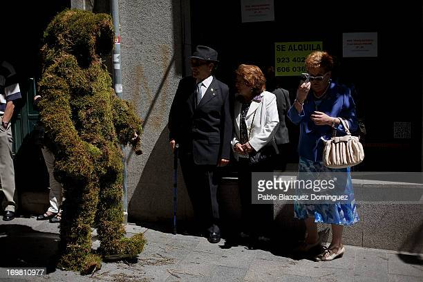 People watch Hombres de Musgo 'Moss Men' taking part in the Corpus Christi procession on June 2 2013 in Bejar Salamanca province Spain The tradition...