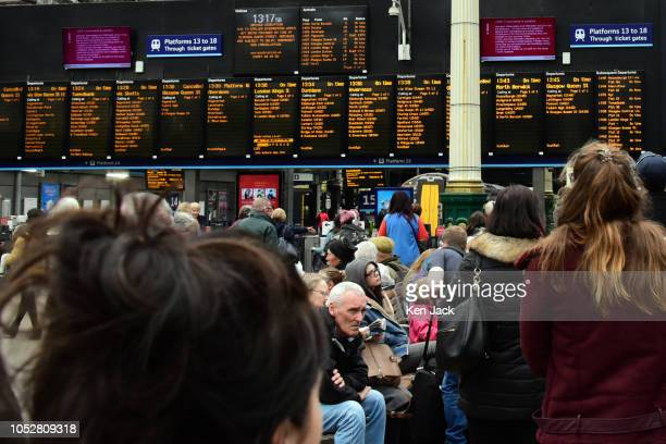 People watch information screens and destination boards in Waverley Station as travellers were cautioned about possible disruption to east coast...