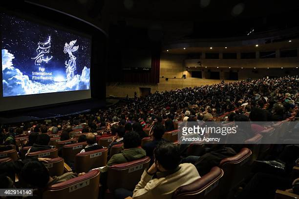 People watch Iranian actress and director Soheila Golestan's movie Two during the premiere within the 33rd Fajr International Film Festival held at...