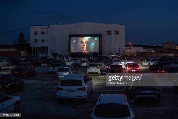 People watch 'Joker' movie from their cars at a temporary drive-in theatre held in a disco club car park amid the ongoing Covid-19 pandemic on May...