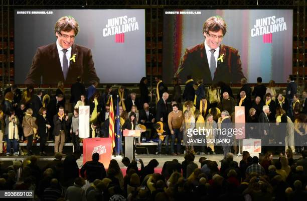 People watch 'Junts per Catalonia' JUNTSXCAT grouping candidate for the upcoming Catalan regional election deposed regional president Carles...