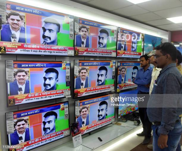 People watch live updates of Wing Commander Abhinandan Varthaman after he is released who was in Pakistan after his MiG 21 jet landed across the LoC...