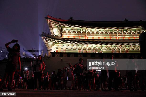People watch 'Media Facade on Heungnyemun Gate' the lighting performance in Gyeongbokgung Palace celebrating the 71th Independence Day on August 15...
