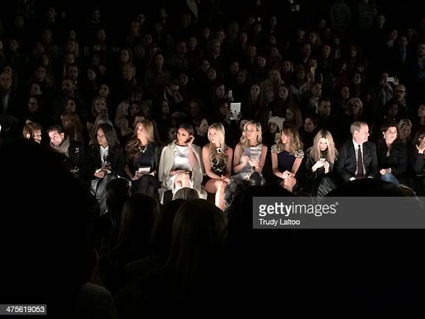 People watch models walk the runway at the Badgley Mischka show during MercedesBenz Fashion Week Fall 2014 at Lincoln Center on February 11 2014 in...
