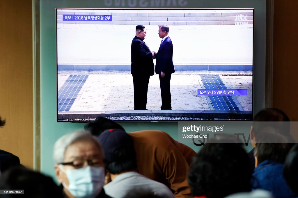People watch Moon Jae-in and Kim Jung-Un's meeting at the MDL(Military Demarcation Line) in Panmunjom for Inter-Korean Summit in television news broadcast at the Seoul Railway station on April 27, 2018 in Seoul, South Korea. North Korean leader Kim Jong Un and South Korean President Moon Jae-in meets at the border today for the third-ever inter-Korean summit talks since the 1945 division of the peninsula.