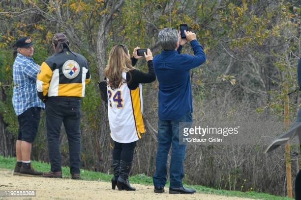 People watch near the site of crashed helicopter that was carrying former NBA star Kobe Bryant on January 26 2020 in Calabasas California According...