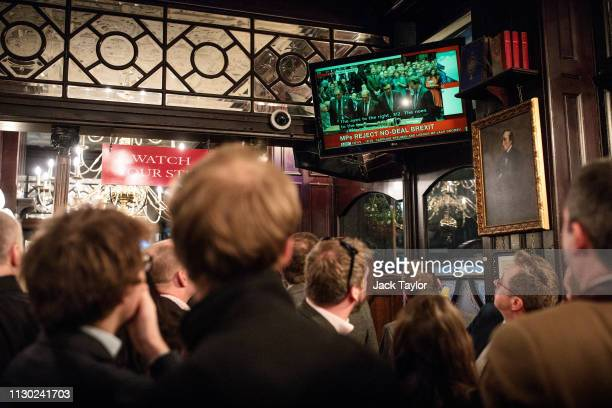 People watch news coverage of the Parliamentary vote on a 'No Deal' amendment in a pub on Whitehall on March 13 2019 in London England MPs vote to...