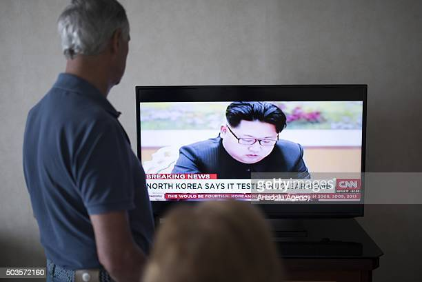 People watch news on TV at a hotel room in Phnom Penh Cambodia after North Korea said Wednesday it had successfully carried out a hydrogen bomb test...