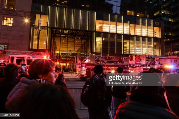 People watch NYPD officers and first responders assess the scene of a fire at Trump Tower on April 7 2018 in New York City One person has reportedly...