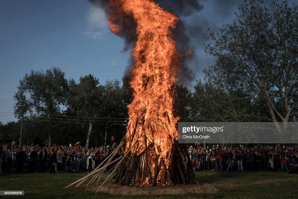 People watch on as a large bonfire is lit during the Kakava Festival on May 5, 2018 in Edirne, Turkey. The annual Kakava (Hõdõrellez) spring festival celebrates the coming of spring amongst the Roma community.