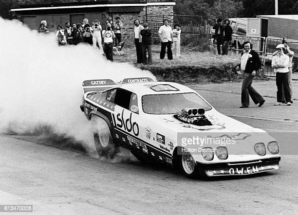 People watch Owen Haywood in his SLD Oldings Houndog racecar who will challenge for the Hot Rod'n'Custom UK Funny Car Eliminator title at the World...