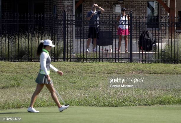 People watch play from a house on the second hole during the first round of the Energy Producers Inc Texas Women's Open on June 02 2020 in The Colony...