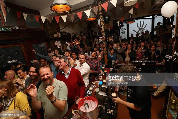 People watch Singer Tom Jones perform in the Wheel Barrow pub as part of Guinness celebrations for Arthur's Day on September 27 2012 in London...
