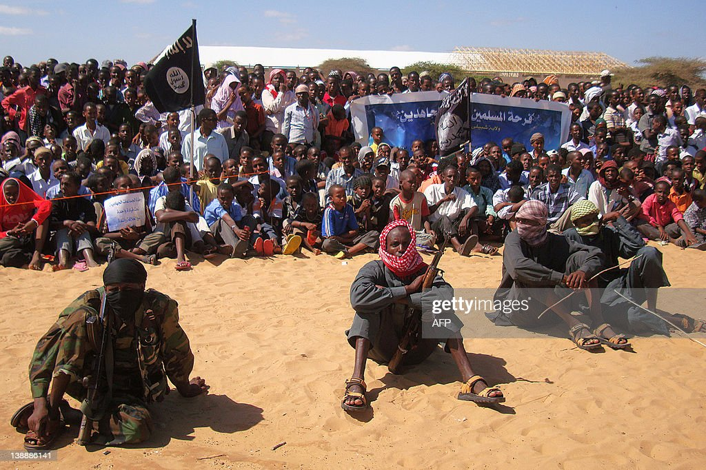 People watch Somali Al-Shebab fighter on : News Photo