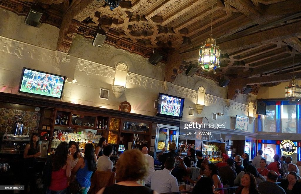 People watch Super Bowl XLVII , the San Francisco 49ers vs The Baltimore Ravens, on televisions in Hollywood's oldest restaurant and pub Pig'n Whistle on February 03, 2013 in Hollywood ,California.The Baltimore Ravens are making their first Super Bowl appearance since they last won in 2000.