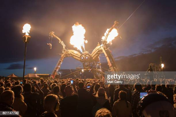 People watch the Arcadia show at the Glastonbury Festival site at Worthy Farm in Pilton on June 25 2017 near Glastonbury England Glastonbury Festival...